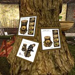 stump chairs with candles in them - Torley Linden
