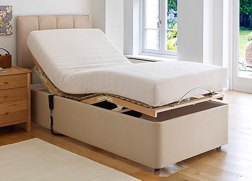 A cream adjustable bed.