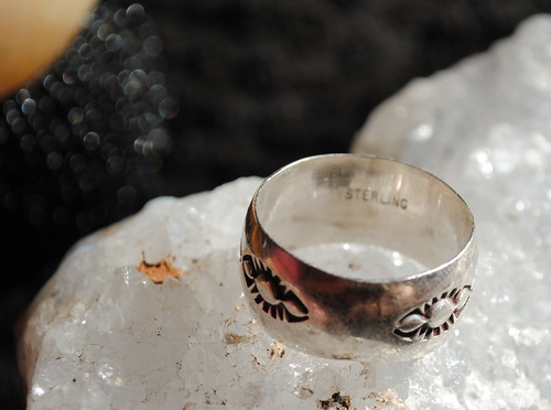 Close on silver ring on top of quartz rock