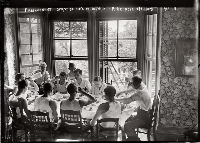 Syracuse freshmen on the rowing team sit around the dinner table on June 19, 1908