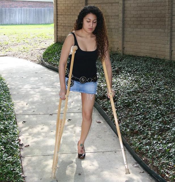 SAK Amputee Women With Wooden Crutches