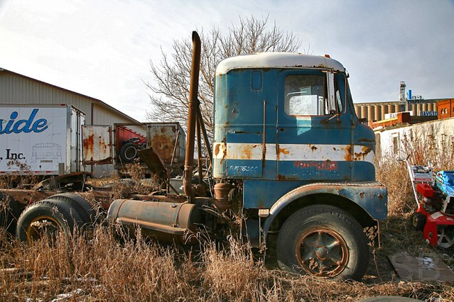 old blue and white semi truck