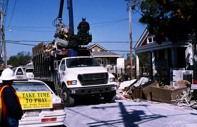 New-Orleans post Katrina Sept.2005: cleaning crew & taxi ad