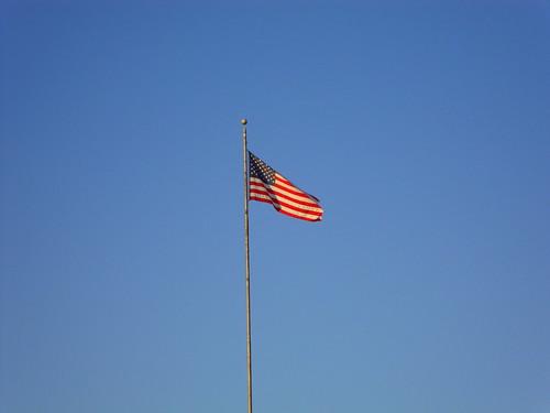 carnival sky usa festival wisconsin fun us unitedstates flag americanflag bluesky fair patriotic entertainment flagpole midway wi amusements starspangledbanner oldglory starsstripes chippewafalls northernwisconsinstatefair