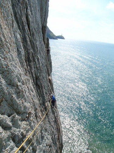 Sun, 2010-08-08 15:18 - Graeme on P2 of A Dream of White Horses (HVS), Gogarth North Stack, Anglesey, North Wales.  One of the most celebrated routes in North Wales.  Holds are positive and good, protections are solid, situation and exposure are amazing.  Lead by Masa, (hanging) belaying.