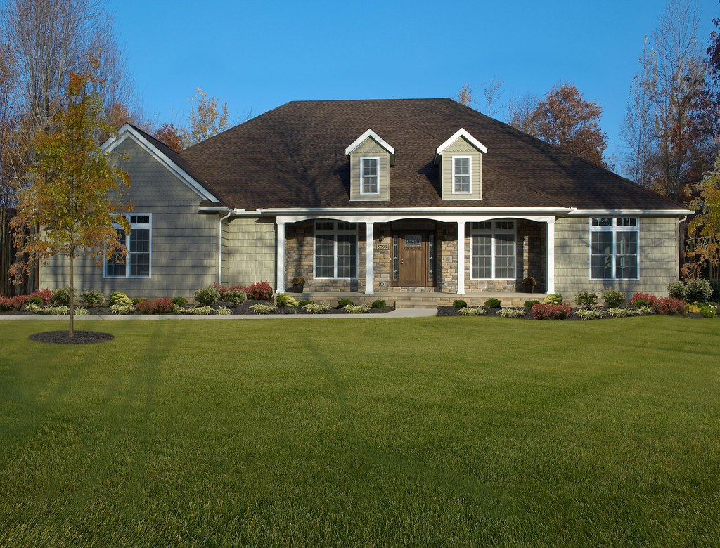 Alexandria with stone shake siding front porch and dorm