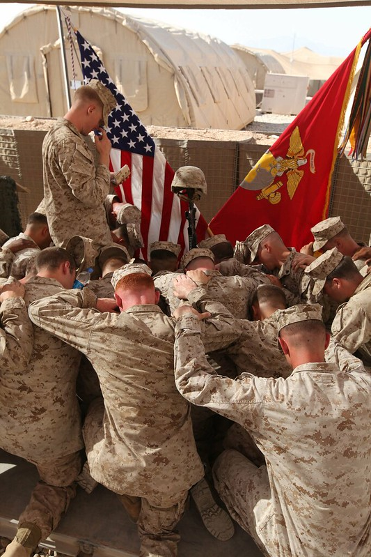 Marines pray for fallen brother