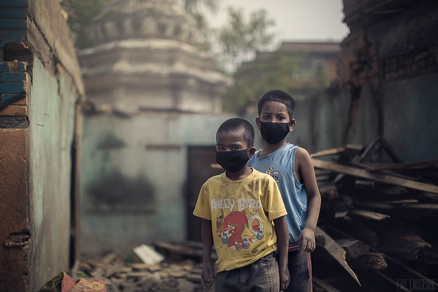 Two brothers in the middle of their own destroyed home after the earthquake. Kathmandu, Nepal