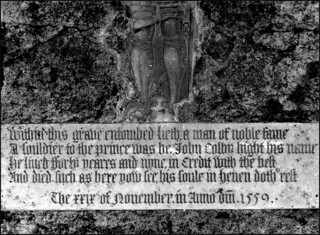 within this grave entombed