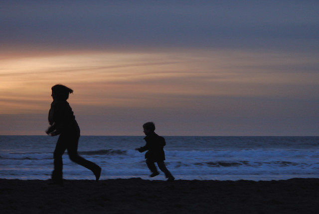 Mother and child running; Ocean Beach, San Francisco (2009)