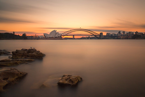 sydneyoperahouse harborbridge sydney newsouthwales australia nsw harbor ocean bay water sunset evening sky clouds rocks longexposure le cityscape landscape landscapes