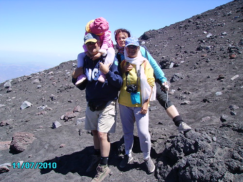 On her first visit to Etna's summit craters, the volcanologist's daughter fell asleep on his shoulders