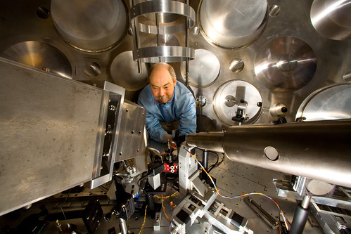 Scientist adjusts diagnostics for an experiment at Trident