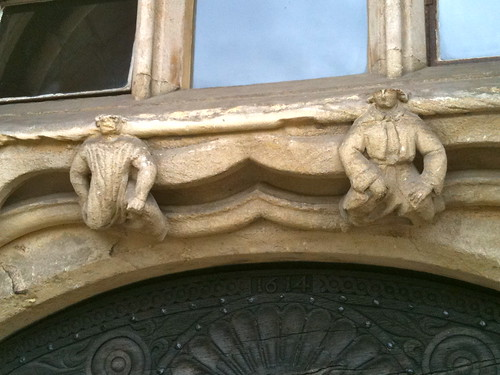 Close up of gargoyles above side entrance to Gloucester Cathedral | by Tip Tours