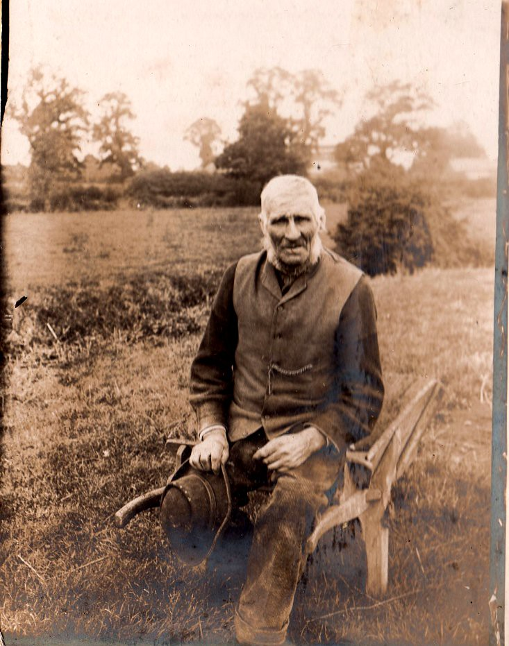Old man with wheelbarrow