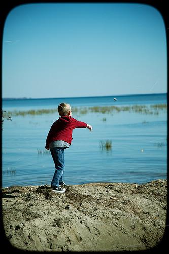 boy beach rock michigan throw lakestclair