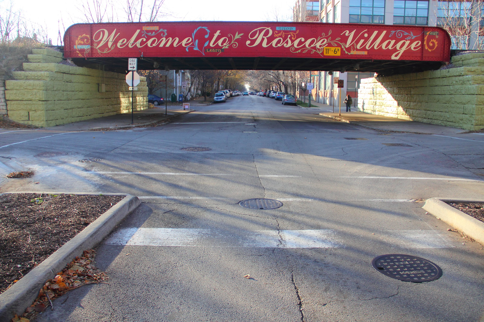 """New """"Welcome to Roscoe Village"""" Painted Sign on Roscoe at the Train Tracks"""