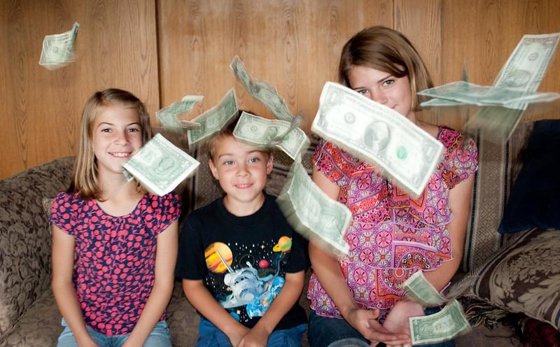 kids money dollar bills tossed