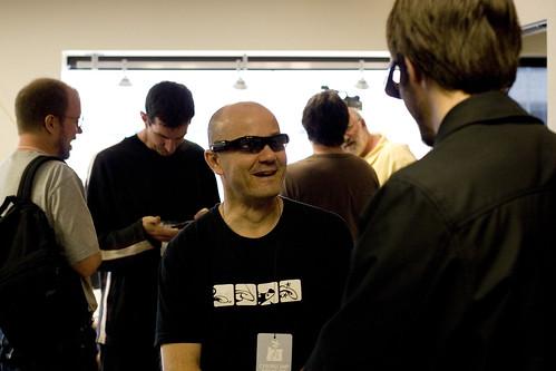 @neophiliac tries on video camera sunglasses - CyborgCamp Morning   by caseorganic