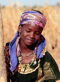 West African girl daily pounds grain for her family's daily meal | by International Livestock Research Institute
