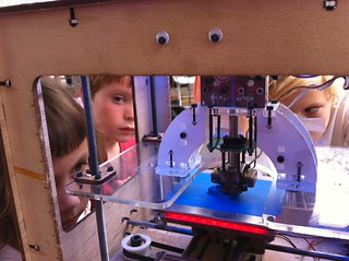 Kids surrounding the MakerBot at makerfaire. | by bre pettis