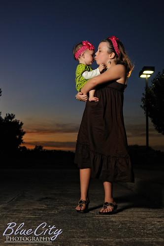 family girls sunset portrait baby girl sisters portraits twilight streetlight kiss texas dusk tx picture lakejackson brazosportcollege clute bluecityphotographycom
