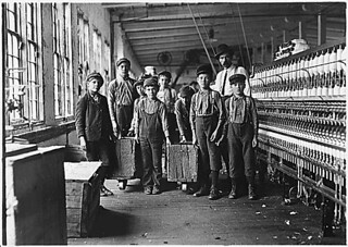 Some of the doffers and the Supt. Ten small boys and girls about this size out of a force of 40 employees. Catawba Cotton Mill. Newton, N.C., 12/21/1908