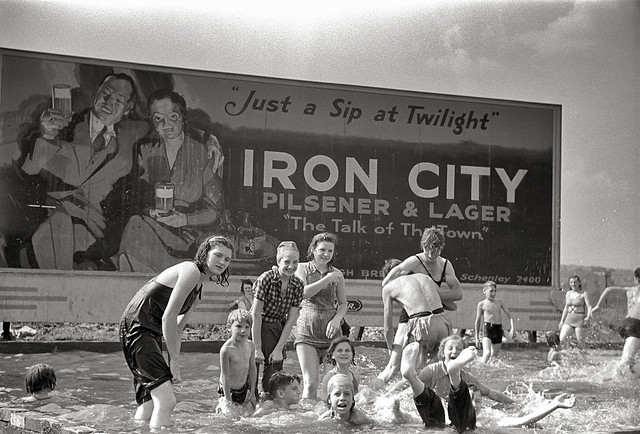 A homemade swimming pool for steelworkers' children in Pittsburgh, Pennsylvania. Photograph by Arthur Rothstein, July, 1938
