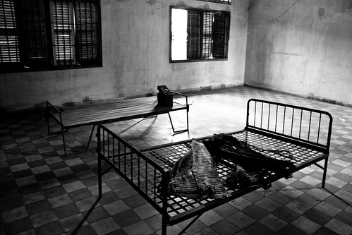 Prisoner beds in S21 Phnom Penh | by worldbeyond