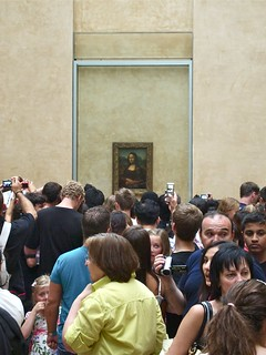 The Mona Lisa Performs for Tourists | by Stew Dean