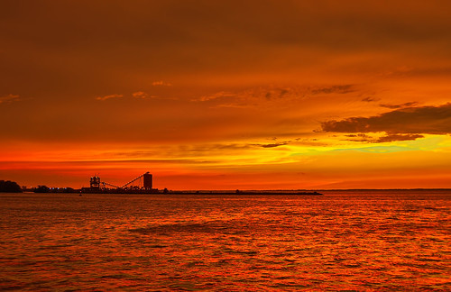 sunset orange water yellow nikon lakeerie explore brilliant sandusky afterthestorms d90 sanduskybay coaldock nikond90 jacksonstreetpier explorejune282010