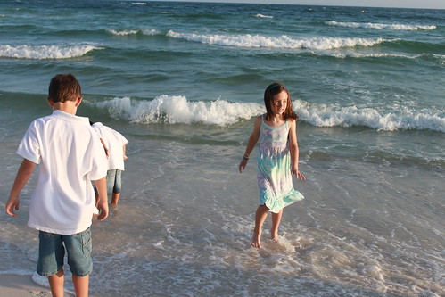 Kids playing in the waves