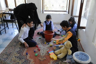 A teacher works with special needs students at a school | by World Bank Photo Collection
