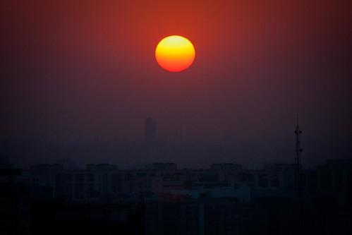 africa city sunset red sky orange sun egypt cairo pollution