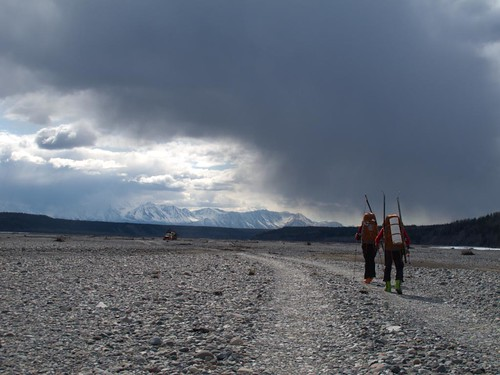 Fri, 2010-05-07 16:42 - Dylan Taylor and Danny Uhlmann walking down the Nizina River floodplain near the Nizina bridge on a 100-mile ski/hike from Skolai Pass to McCarthy, Wrangell Mountains, Alaska.