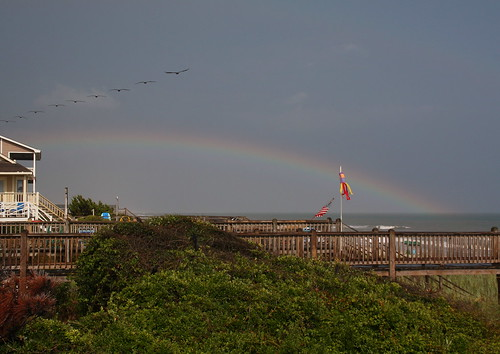 ocean sky storm beach nc rainbow afterthestorm flag northcarolina stormy deck usflag roygbiv windsock holdenbeach davidhopkinsphotography