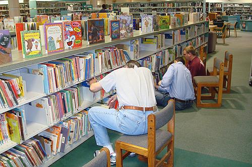Datatel Volunteers Organizing Books at CE