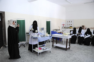 Ibtisam, (left) instructs a class in midwifery at the Health Service Institute | by World Bank Photo Collection