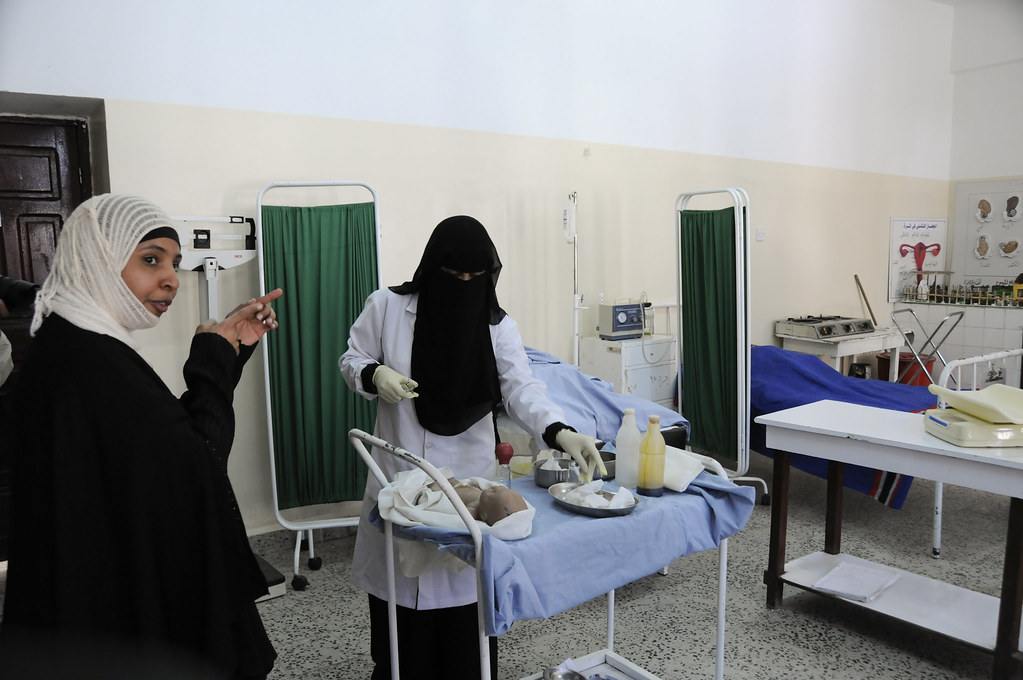 Ibtisam, (left) instructs a class in midwifery at the Health Service Institute