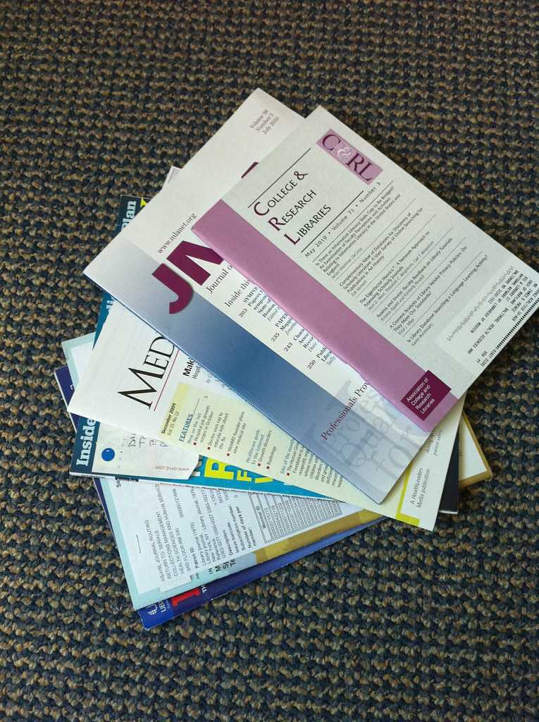 Image result for stack of journals