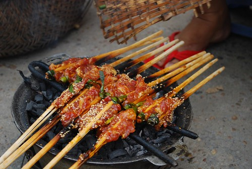 Pork skewers on the grill - Banh Uot hawker | by avlxyz