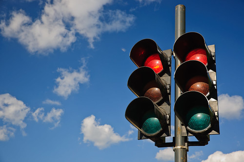 A couple of red traffic lights against a blue sky | by Horia Varlan