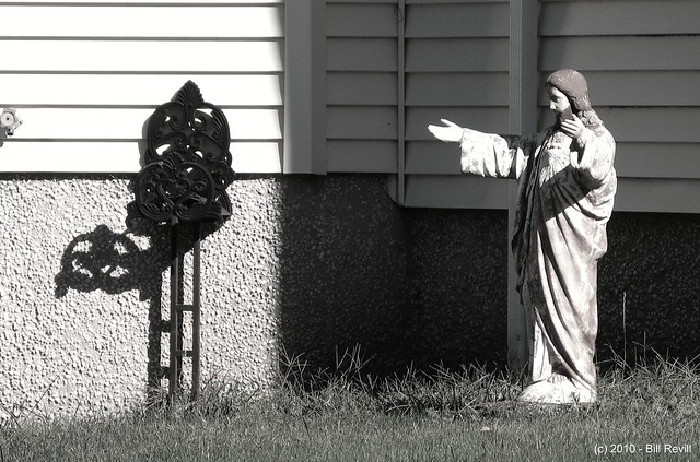 Christ and the garden hose holder