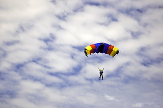 Parachute jumper against cloudy sky | by Horia Varlan