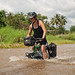 Tara Cycling in a Flood by goingslowly