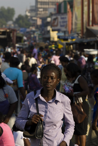 Woman walks through the city | by World Bank Photo Collection