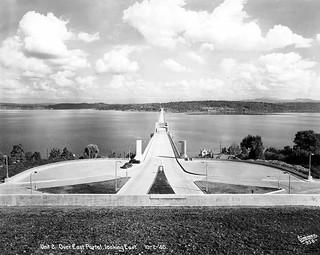 Looking east on the completed Lake Washington Floating Bridge, the only concrete pontoon bridge in the world, Mercer Island, Washington