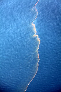Strands of oil at site