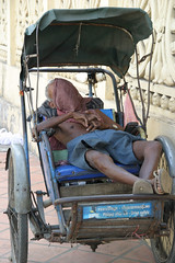 A nap in the cyclo, Phnom Penh - Cambodia