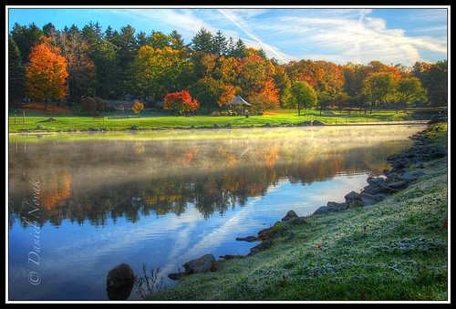 park morning blue autumn light red sky orange usa sun white mist lake ny newyork color reflection green fall nature colors grass yellow fog clouds sunrise season landscape early town us pond rocks frost glow seasons unitedstates bright bank upstate steam greenlake shore western